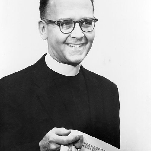 Rev. Walter J. Ong, SJ, receiving award in the Knights' Room of Pius XII Memorial Library. (22 February 1963)  Photographer Rev. B. T. Lukaszewski, SJ.